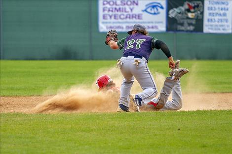 Corbin Davis (27) makes the tag at the bag.