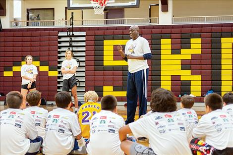 NBA and LA Laker legend Michael Cooper instructs a group of future prep stars in the game's fundamentals.