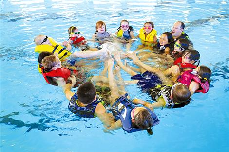 Polson  second-grade  students learn to swim due to a collaboration between  Mission Valley  Aquatics, the  Greater Polson Community  Foundation, and  Polson School District.