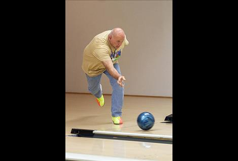 Brian Dinsmore rolls the ball in the bowling competition.