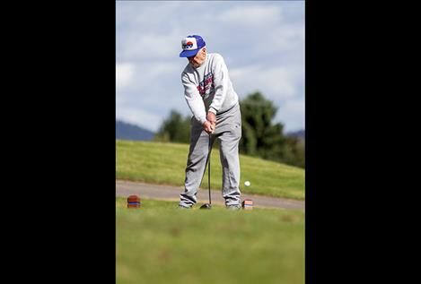 Dick Moore launches a ball during the golf ball driving competition.