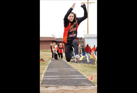 Sydney Castor competes in the long jump.