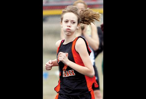 Alexia Pierre rounds the track during the Ronan Invitational.