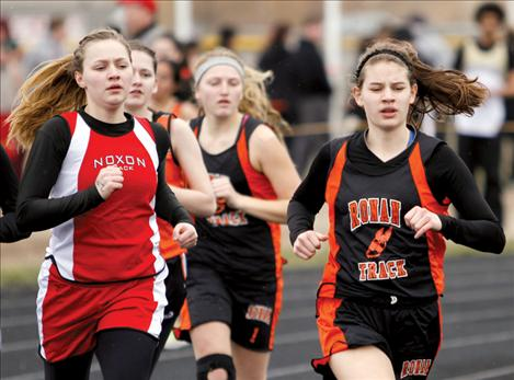 Ronan-St. Ignatius runner Kaylie Durglo strides past competitors during the Ronan Invitational last month.