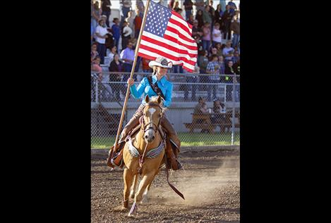 2017 Northwest Montana Pro Rodeo Queen Kayla Seaman enters the arena with Old Glory.