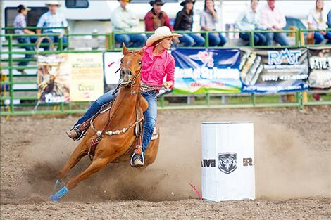 Abby Knight races to a first place win in the barrels.
