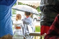 Rain doesn't dampen firemen's picnic, auction