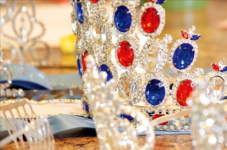 Several crowns from past wins are set out on the table.