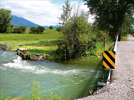 Floodwaters from recent rainstorms caused damage to Delaney Way near McDonald Lake Road in Charlo.