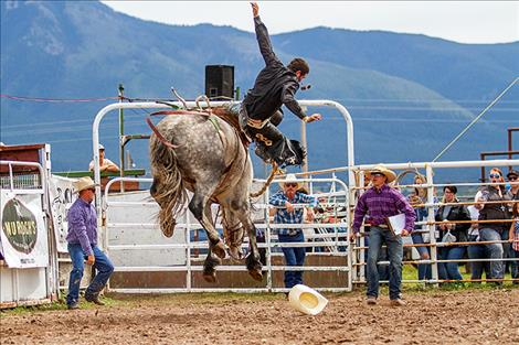 An angry bronc catapults a rider into the air.