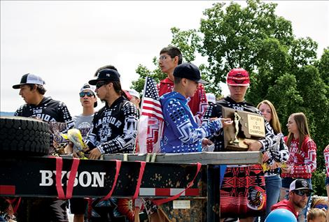 The Arlee Warriors ride on a float during a Fourth of July  parade to bring awareness to suicide prevention and  continue to be role models in the community.