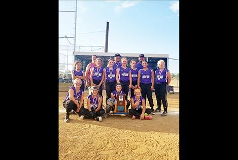 The 12U Purple Wave pose for a photo after taking second overall at the Montana USA Junior Olympic State Softball Tournament June 8 in Great Falls.