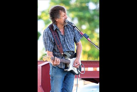 Ken Sederdahl of the Kenny James  Miller Band  entertains the crowd.