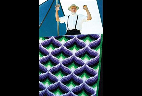 Handmade quilts of all colors are sold at the  Annual Amish  Community  Auction along with hundreds  of other items.