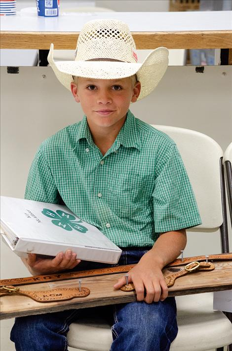 Koy  McAllister, 11, waits to share his leather work with a judge on Monday.
