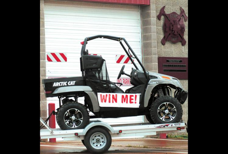 """This Arctic Cat Prowler 550 XT 4-wheeler is being raffled by the St. Ignatius Volunteer Fire Department to raise general operating funds. Only 500 tickets will be sold at $50 per ticket.  """"We're hoping everybody buys a ticket and supports the fire department,"""" volunteer fireman Joe Mitchell said.  """"We're here to serve you."""""""