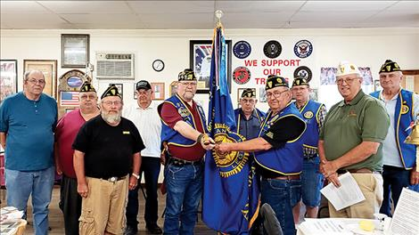 From left to right are Post members Dale Morgan, Service Officer Penrod Davis, Junior Shooting Sports Chairman Melvin Quakenbush, Finance Officer Hank Dolezal, Commander Glen Sharbono, Chaplain Ed Cornelius, Past Commander Jack Fay, Vice Commander Tom Leafty, Visiting Department Vice Commander Jeff Nelson and Highway Fatality Marker Chairman Jerry Fisher.