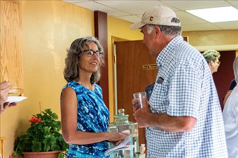 Congressional hopeful Kathleen Williams converses with a constituent during the grand opening of the Montana Democratic Party campaign office in Polson.