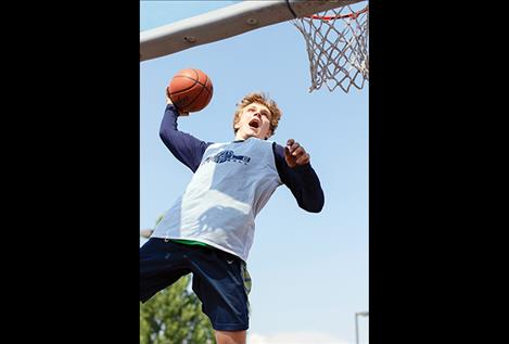 A street baller shows off his hoops during the 3-on-3 slam dunk contest.