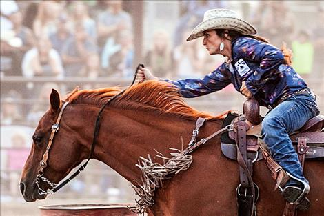 Right: Kyla Jaeger competes in ladies barrel racing on Saturday night.