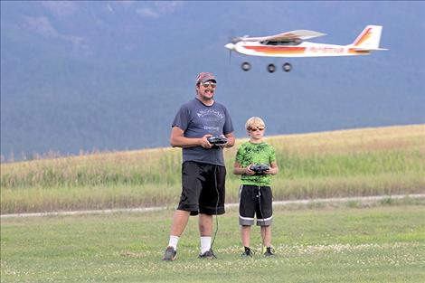 Eric Kendall and his son Ryan enjoy an evening of flying, left.