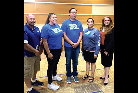 Principal Shawn Hendrickson stands (center) with teachers and staff members at OPI's award ceremony held at Montana State University in June. The St. Ignatius School District was the first school to get a Platinum Award two years in a row and the first reservation school in the state to get it.