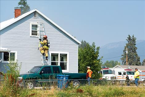 Ronan volunteer firefighters respond to a house fire on Wednesday.
