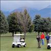 "Members of ""Tie Dye Muscle,"" one of 20 teams in Saturday's CASA fundraising golf tourney in Polson, watch as  teammate Aaron Auclaire of Kalispell takes a swing. Entry fees, donations and the proceeds of a silent auction support Court Appointed Special Advocates for Children in Lake County. The tourney also offered an auction where players could bid on local celebrities to join their team."