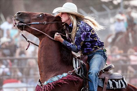 Paula Symington competes in the Ladies Barrel Race.
