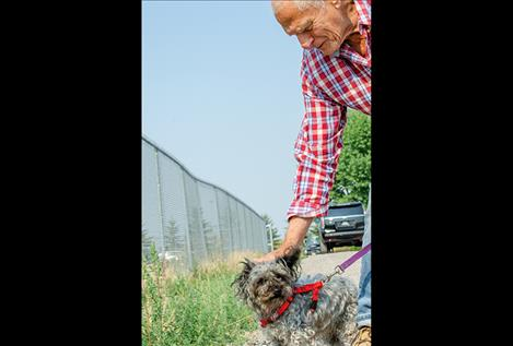 Jerry Schoenkopf volunteers to walk Marley.