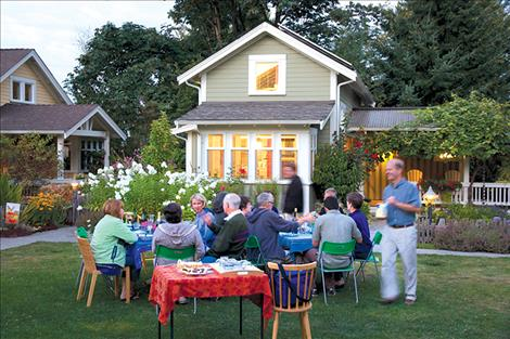 Residents gather in the community space of a pocket neighborhood designed by architect Ross Chapin in the town of Langley on Whidbey Island, Washington.