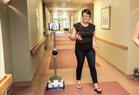 Kaley Burke and Bill Thomas showcase the Ohmni telepresence robot, which is being tested as a way to help connect residents at Missoula's Grizzly Peak, a senior-living and retirement community, with loved ones who live far away.