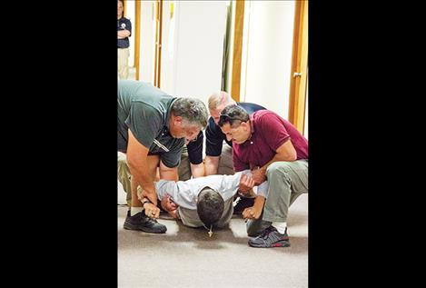 Emergency response teams learn to lift a victim.