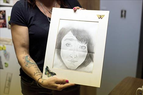 Jennifer holds a portrait drawn by Jack's long-distance girlfriend of two years, Edith Dively, during a Skype session. Dively met his family for the first time during his celebration of life.