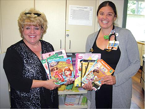 Providence St. Joseph Medical Center  pediatrician Emily Hall, DO, recently  accepted a donation of children's books from Laura Burrowes, Lake County  Representative for the Community Action Partnership of Northwest Montana.
