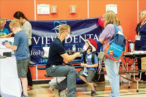 Dr. Joshua Ricks provides dental assessments for children at the fair.
