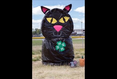 The 4H Club's hay bale cat sits along U.S. Highway 93 in Ronan.