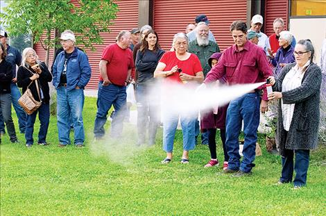 Steve Primm, People and Carnivores founder, shows participants how to use bear spray the correct way.