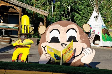 The Ronan Library crew turned a hay bale into Curious George, a story book character.