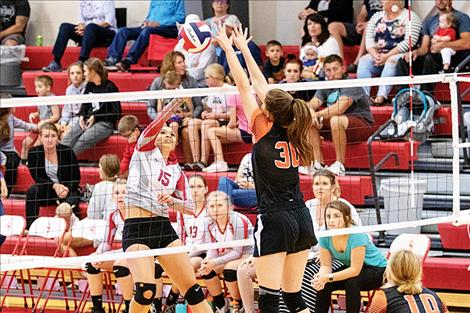 Rob Zolman / Valley Journal Arlee Scarlet Louetta Camel battles at the net.