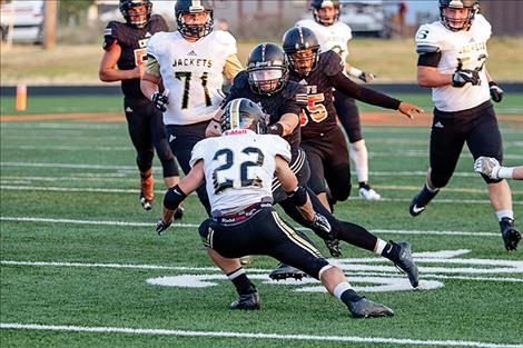 Ronan Chief quarterback Eric Dolence fights for some running room.