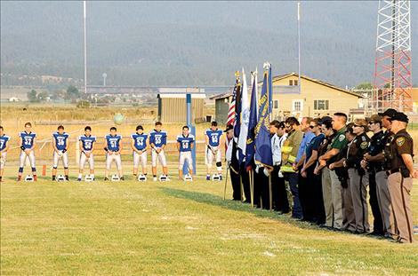 The Mission Valley Honor Guard, local law  enforcement, firefighters, emergency responders and soldiers remember the heroes of 9/11 before a football game on Friday.