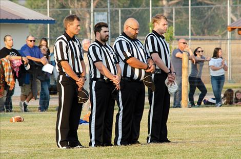 Football  referees honor  the heroes.