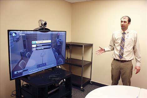 Glendive Medical Center CEO Parker Powell shows off the hospital's telemedicine system. For the past few years, the hospital has used telemedicine via video to provide mental health services for patients.