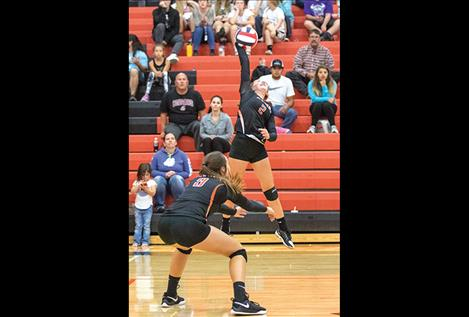 Lady Bulldog Addison Arlint battles Maiden Madison Clairmont at the net.