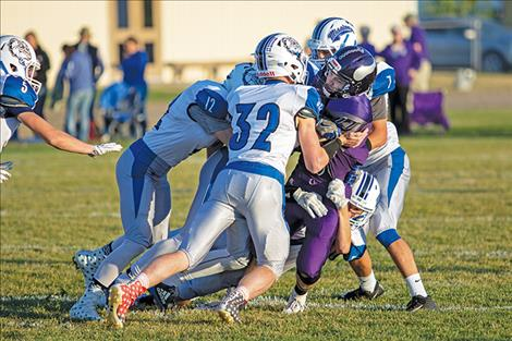 Bulldogs stop Viking running back.