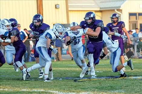 Viking Wrangler Gaustad slips past Bulldog defender.