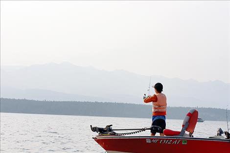 Donovan Beeks casts his line into the lake in hopes of reeling in a mack.