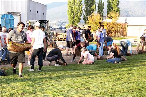 Ronan students put sod down at the Boys and Girls Club of the  Flathead  Reservation  and Lake County last week  at the new  location where Total Home was once located.