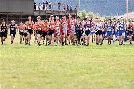 The varsity boys' starting line takes off during the Mission Invite cross-country meet last month.